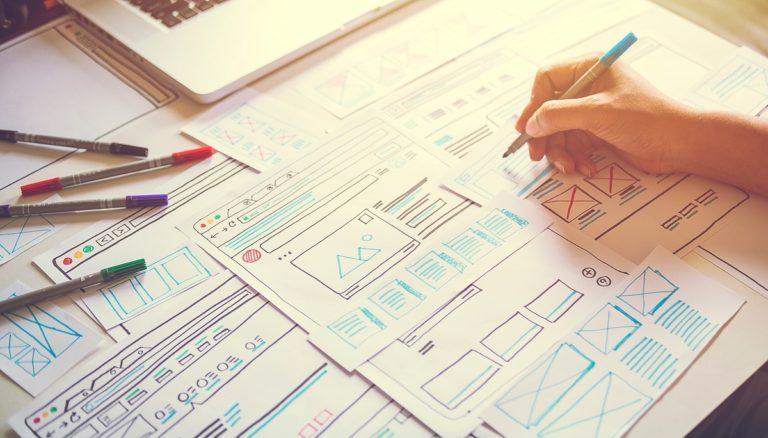 Graphic designer sketching website design