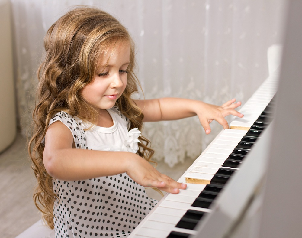a kid playing piano