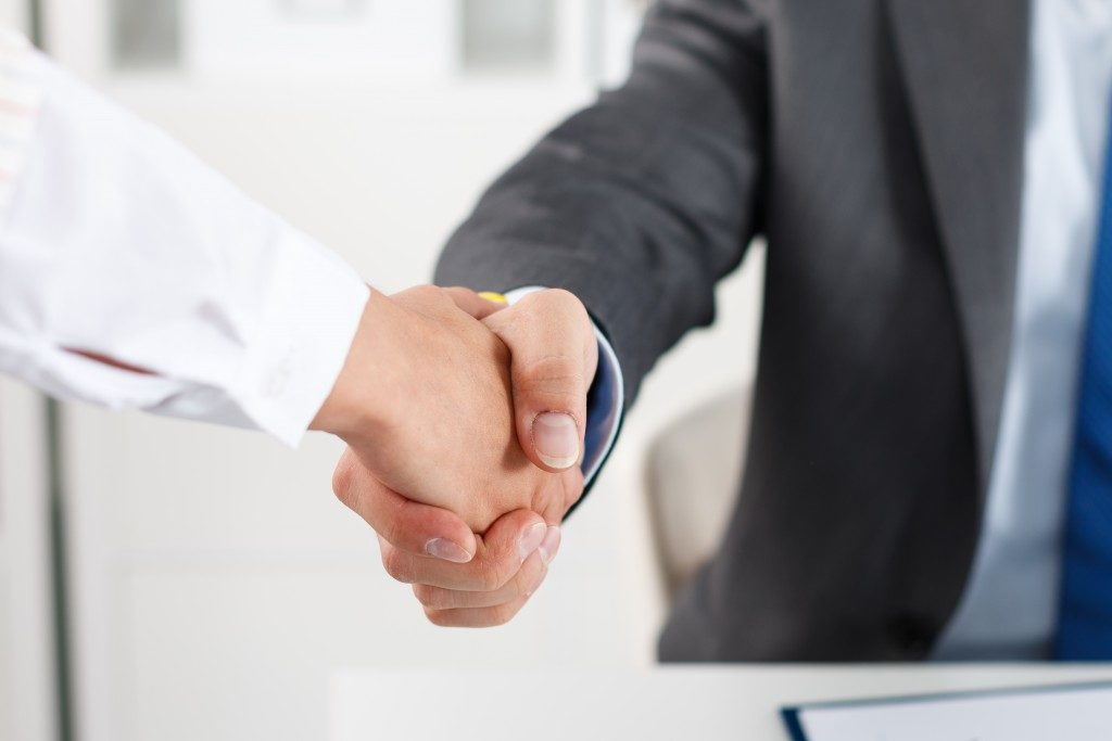 Businesspeople shaking hands after a negotiation