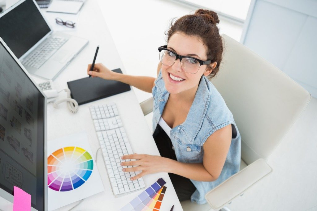 woman designing photos on her computer