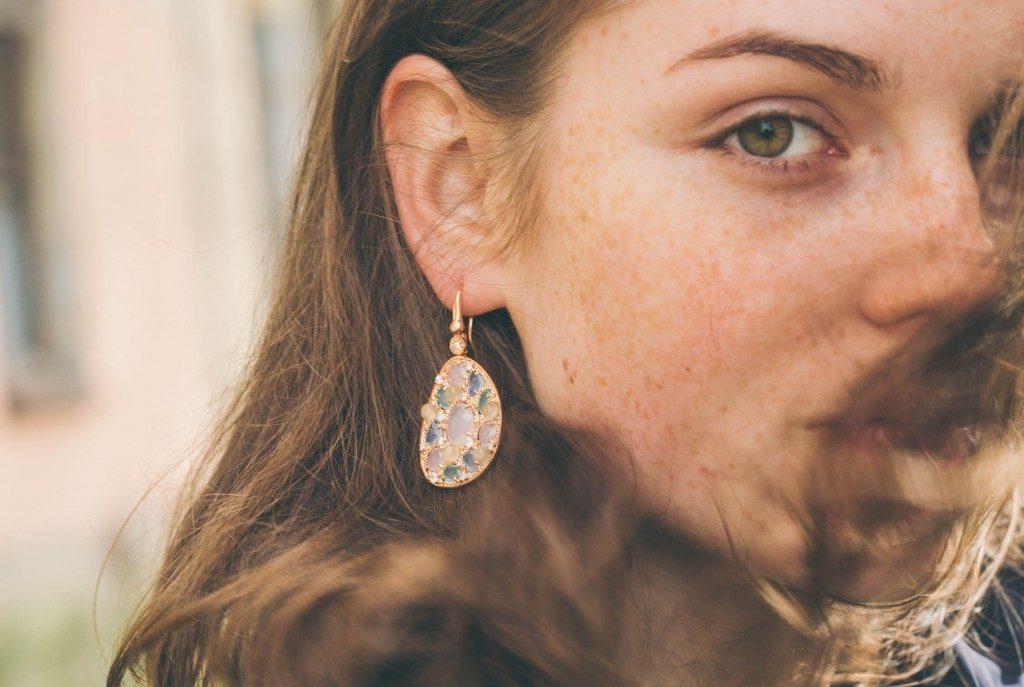 woman wearing a diamond earring