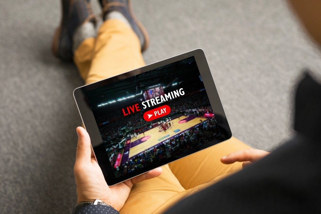 Man watching sports on live streaming
