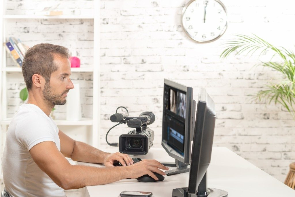 video editor with computer and professional video camera